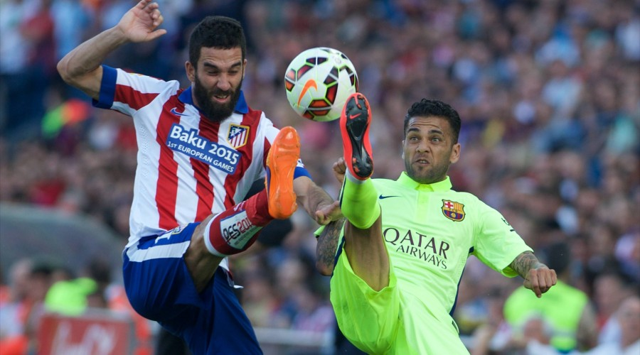 FC Barcelona Barca Defender, Daniel Alver da Silva - DANI ALVES, number 22 . Atletico de Madrid Midfielder, Arda Turan - ARDA, number 10. Round 37 of the BBVA league, soccer match between Atletico de Madrid - FC Barcelona at the Vicente Calderon estadium, Madrid - Spain by May 17, 2015. PHOTO: Gregorio Lopez. PUBLICATIONxINxGERxSUIxAUTxHUNxONLY