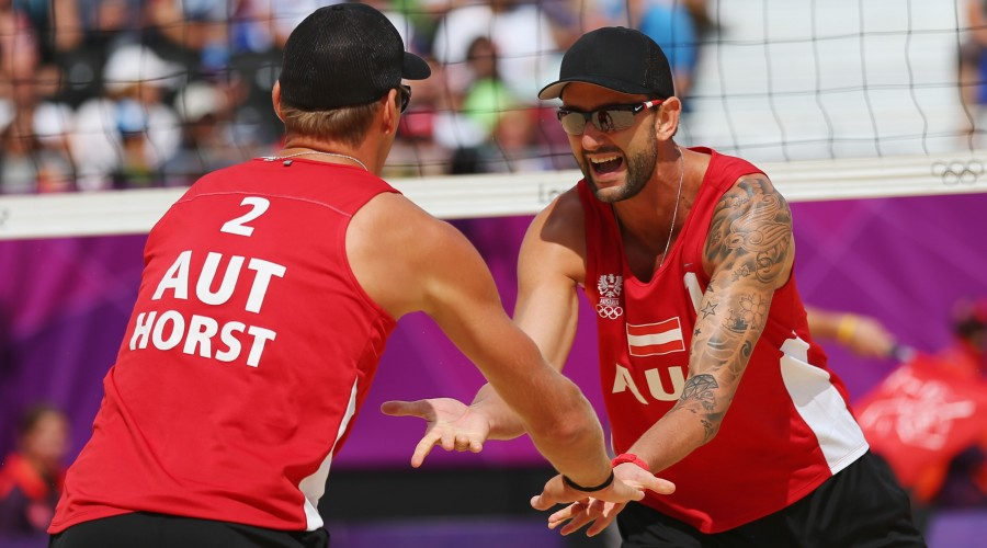 LONDON, ENGLAND - JULY 29:  Alexander Horst and Clemens Doppler of Austria celebrate during Men's Beach Volleyball Preliminary match between Brazil and Austria on Day 2 of the London 2012 Olympic Games at Horse Guards Parade on July 29, 2012 in London, England.  (Photo by Ryan Pierse/Getty Images)