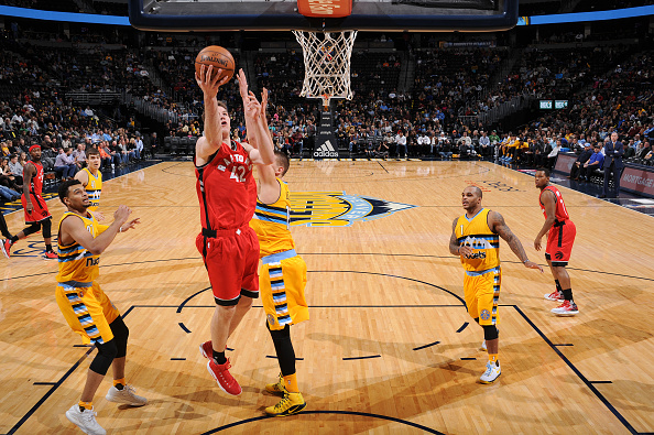 DENVER, CO - NOVEMBER 18: Jakob Poeltl #42 of the Toronto Raptors goes up for a lay up against the Denver Nuggets on November 18, 2016 at the Pepsi Center in Denver, Colorado. NOTE TO USER: User expressly acknowledges and agrees that, by downloading and/or using this Photograph, user is consenting to the terms and conditions of the Getty Images License Agreement. Mandatory Copyright Notice: Copyright 2016 NBAE (Photo by Garrett Ellwood/NBAE via Getty Images)
