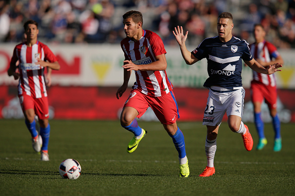 GEELONG, AUSTRALIA - JULY 31:  Theo Hernandez of Atletico Madrid runs with the ball during the match between Melbourne Victory and Atletico de Madrid at Simonds Stadium on July 31, 2016 in Geelong, Australia.  (Photo by Darrian Traynor/Getty Images)