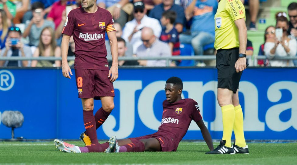 GETAFE, SPAIN - SEPTEMBER 16: Ousmane Dembele of FC Barcelona lies injured during the La Liga match between Getafe and Barcelona at Coliseum Alfonso Perez on September 16, 2017 in Getafe, Spain. (Photo by Denis Doyle/Getty Images)
