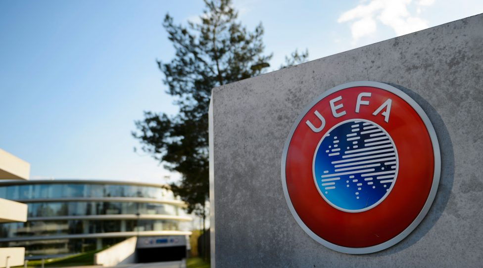 A photo taken on April 6, 2016 shows the logo of European football body UEFA at the UEFA headquarters in Nyon.  Swiss police raided the headquarters of European football body UEFA on April 6 following the latest revelations of a web of Panama-based offshore financial dealings by the rich and famous. The raid came after the so-called Panama Papers revealed that newly elected FIFA president Gianni Infantino signed TV rights contracts for the Champions League with a company headed by two defendants later caught up in the corruption scandal that engulfed football's world body.  / AFP / FABRICE COFFRINI        (Photo credit should read FABRICE COFFRINI/AFP/Getty Images)