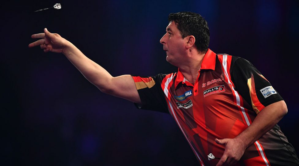 LONDON, ENGLAND - DECEMBER 21:  Mensur Suljovic of Serbia throws during his first round match against Ron Meulenkamp of the Netherlands on day seven of the 2017 William Hill PDC World Darts Championships at Alexandra Palace on December 21, 2016 in London, England. (Photo by Dan Mullan/Getty Images)