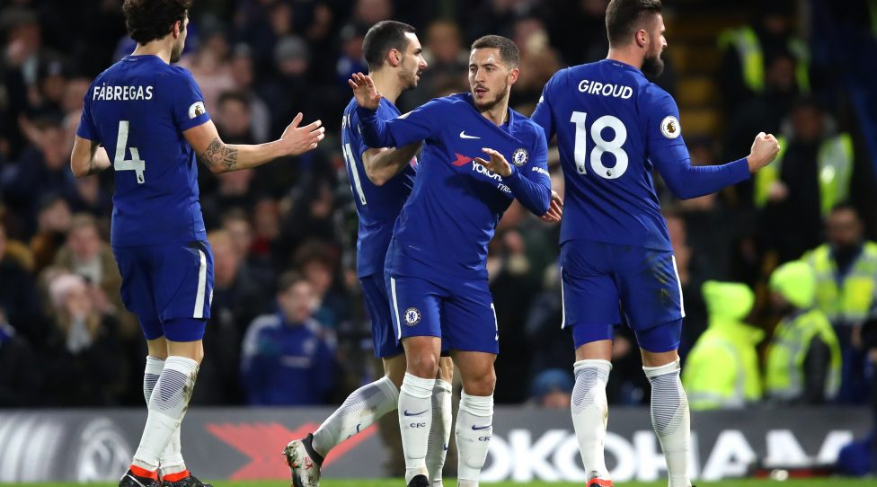 LONDON, ENGLAND - FEBRUARY 12: Eden Hazard of Chelsea celebrates after scoring his sides first goal with Cesc Fabregas of Chelsea during the Premier League match between Chelsea and West Bromwich Albion at Stamford Bridge on February 12, 2018 in London, England.  (Photo by Julian Finney/Getty Images)