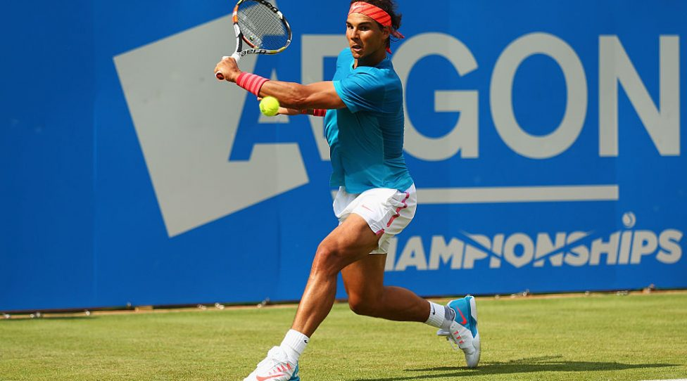 LONDON, ENGLAND - JUNE 16:  Rafael Nadal of Spain plays a backhand in his men's singles first round match against Alexandr Dolgopolov of Ukraine during day two of the Aegon Championships at Queen's Club on June 16, 2015 in London, England.  (Photo by Clive Brunskill/Getty Images)