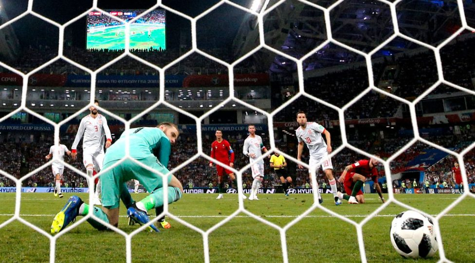 SOCHI, RUSSIA - JUNE 15:  Cristiano Ronaldo of Portugal scores his team's second goal past David De Gea of Spain during the 2018 FIFA World Cup Russia group B match between Portugal and Spain at Fisht Stadium on June 15, 2018 in Sochi, Russia.  (Photo by Dean Mouhtaropoulos/Getty Images)