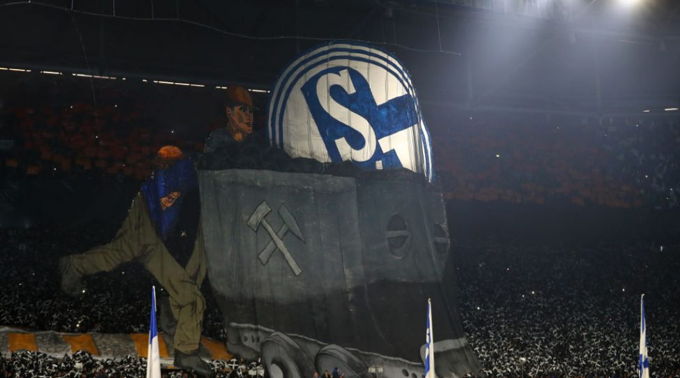 GELSENKIRCHEN, GERMANY - DECEMBER 19:  Fans of Schalke 04 show their support in honouring 250 years of coal mining during the Bundesliga match between FC Schalke 04 and Bayer 04 Leverkusen at Veltins-Arena on December 19, 2018 in Gelsenkirchen, Germany.  (Photo by Dean Mouhtaropoulos/Bongarts/Getty Images)