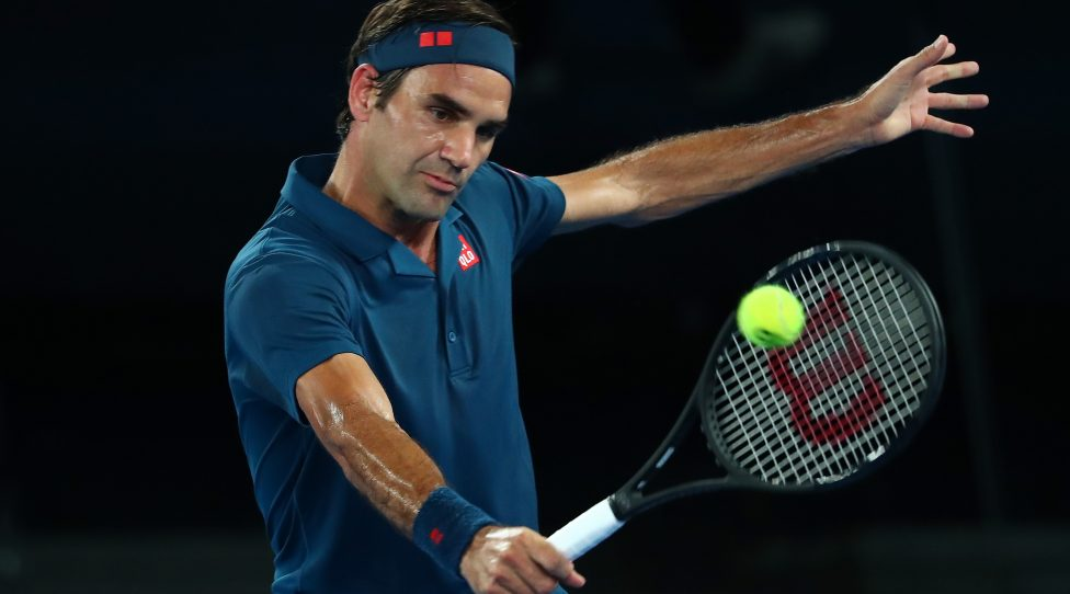 MELBOURNE, AUSTRALIA - JANUARY 14:  Roger Federer of Switzerland plays a backhand his first round match against Denis Istomin of Uzbekistan during day one of the 2019 Australian Open at Melbourne Park on January 14, 2019 in Melbourne, Australia.  (Photo by Michael Dodge/Getty Images)