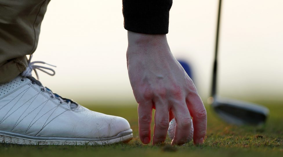 RYE, ENGLAND - JANUARY 04:  A competitor places his golf ball down before taking his shot off the 9th tee during day two of the The President's Putter at Rye Golf Club on January 4, 2019 in Rye, England.  (Photo by Naomi Baker/Getty Images)