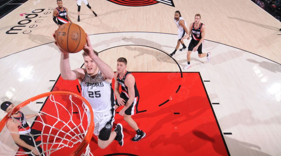 PORTLAND, OR - FEBRUARY 7: Jakob Poeltl #25 of the San Antonio Spurs dunks against the Portland Trail Blazers on February 7, 2019 at the Moda Center Arena in Portland, Oregon. NOTE TO USER: User expressly acknowledges and agrees that, by downloading and or using this photograph, user is consenting to the terms and conditions of the Getty Images License Agreement. Mandatory Copyright Notice: Copyright 2019 NBAE (Photo by Sam Forencich/NBAE via Getty Images)