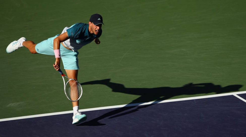 INDIAN WELLS, CALIFORNIA - MARCH 17:   Dominic Thiem of Austria serves against Roger Federer of Switzerland during their men's singles final on day fourteen of the BNP Paribas Open at the Indian Wells Tennis Garden on March 17, 2019 in Indian Wells, California. (Photo by Clive Brunskill/Getty Images)