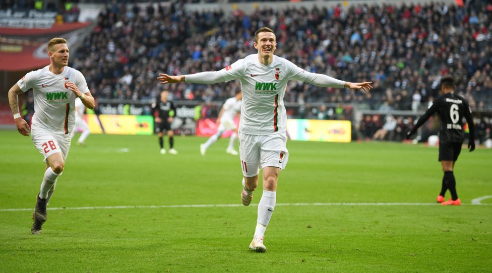14 April 2019, Hessen, Frankfurt/Main: Soccer: Bundesliga, Eintracht Frankfurt - FC Augsburg, 29th matchday in the Commerzbank-Arena. The Augsburg Andre Hahn (l) and goal scorer Michael Gregoritsch cheer after the goal to 1:3. Photo: Arne Dedert/dpa - IMPORTANT NOTE: In accordance with the requirements of the DFL Deutsche Fußball Liga or the DFB Deutscher Fußball-Bund, it is prohibited to use or have used photographs taken in the stadium and/or the match in the form of sequence images and/or video-like photo sequences. | Verwendung weltweit