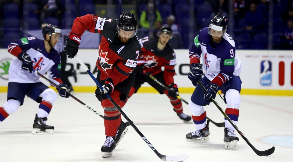 KOSICE, SLOVAKIA - MAY 12: Brett Perlini #9 of Great Britain challenges Sean Couturier #7 of Canada during the 2019 IIHF Ice Hockey World Championship Slovakia group A game between Great Britain and Canada at Steel Arena on May 12, 2019 in Kosice, Slovakia. (Photo by Martin Rose/Getty Images)