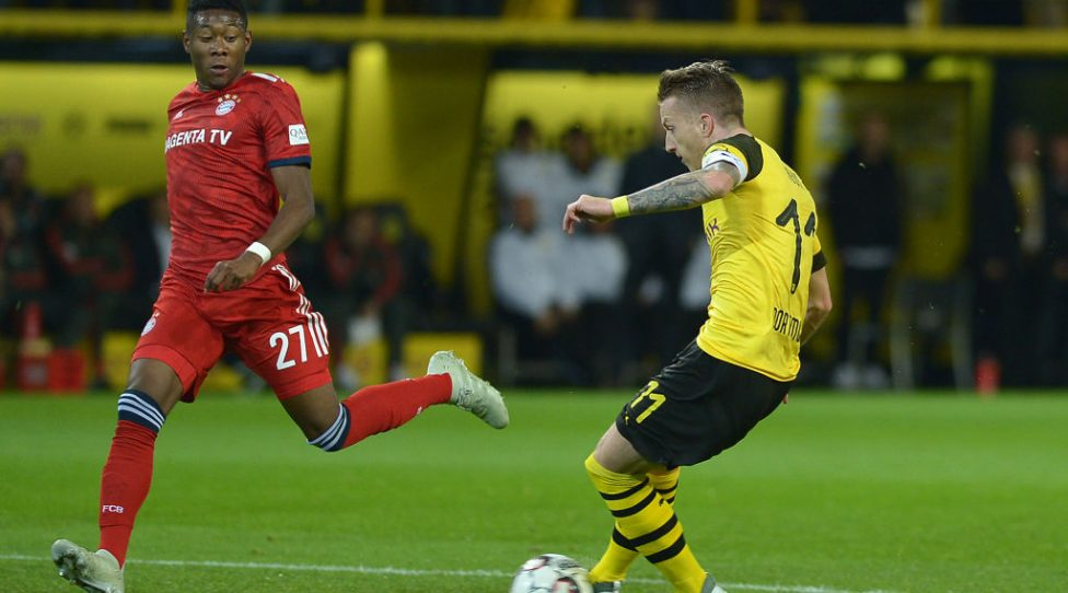 DORTMUND, GERMANY - NOVEMBER 10: Marco Reus of Borussia Dortmund and David Alaba of Bayern Muenchen battle for the ball during the Bundesliga match between Borussia Dortmund and FC Bayern Muenchen at Signal Iduna Park on November 10, 2018 in Dortmund, Germany.(Photo by TF-Images/Getty Images)