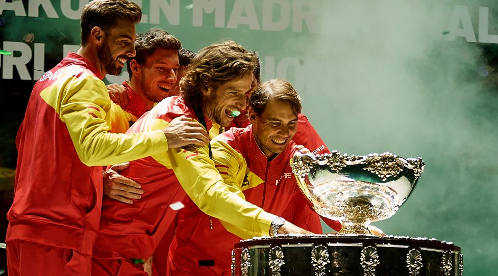 MADRID, SPAIN - NOVEMBER 24: Rafa Nadal of Spain celebrates the victory with the trophy next to his teammates in the Final between Spain and Canada during Day Seven of the 2019 Davis Cup at La Caja Magica on November 24, 2019 in Madrid, Spain. (Photo by David Aliaga/MB Media/Getty Images)