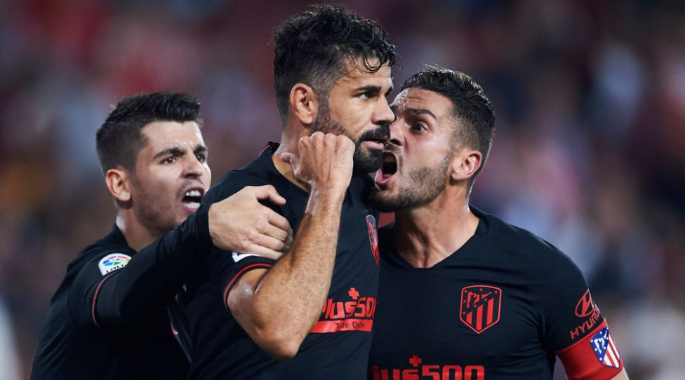 SEVILLE, SPAIN - NOVEMBER 02: Diego Costa of Club Atletico de Madrid celebrates with his teammate Jorge Resurreccion 'Koke' and Alvaro Morata of Club Atletico de Madrid celebrates prior to seeing his goal canceled out for offside after a VAR decision during the Liga match between Sevilla FC and Club Atletico de Madrid at Estadio Ramon Sanchez Pizjuan on November 02, 2019 in Seville, Spain. (Photo by Aitor Alcalde/Getty Images)