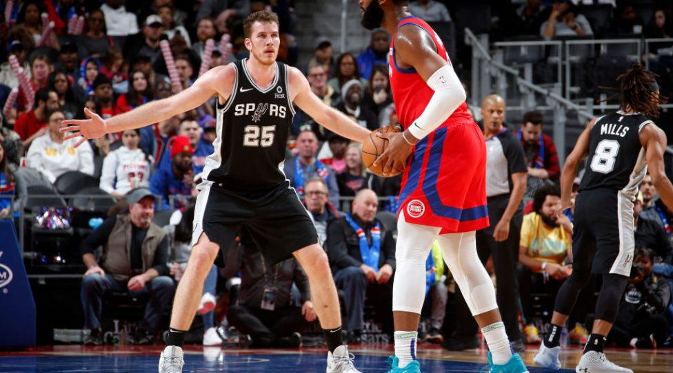 DETROIT, MI - DECEMBER 1: Jakob Poeltl #25 of the San Antonio Spurs plays defense against  Detroit Pistons on December 1, 2019 at Little Caesars Arena in Detroit, Michigan. NOTE TO USER: User expressly acknowledges and agrees that, by downloading and/or using this photograph, User is consenting to the terms and conditions of the Getty Images License Agreement. Mandatory Copyright Notice: Copyright 2019 NBAE (Photo by Brian Sevald/NBAE via Getty Images)