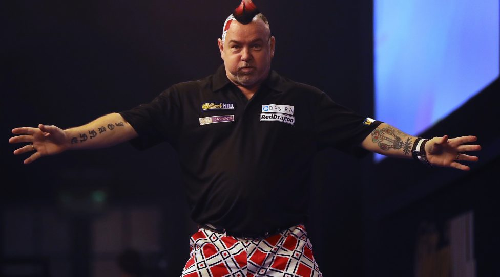 LONDON, ENGLAND - DECEMBER 30:  Peter Wright from Scotland celebrates after throwing a 180 during the quarter final of 2016 William Hill World Darts Championship on December 30, 2016 in London, England. The event is world's biggest darts tournament, with 72 players from across the globe competing across 15 days of the knock out competition.  (Photo by Dan Kitwood/Getty Images)