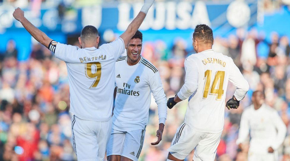 GETAFE, SPAIN - JANUARY 04: Raphael Varane of Real Madrid CF celebrates scoring his team's opening goal with team mates during the Liga match between Getafe CF and Real Madrid CF at Coliseum Alfonso Perez on January 04, 2020 in Getafe, Spain. (Photo by Quality Sport Images/Getty Images)