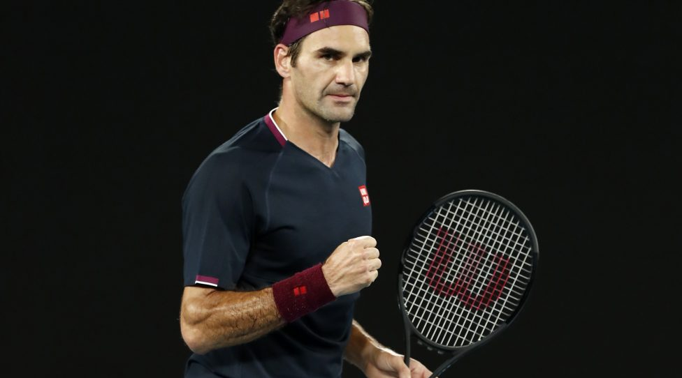 MELBOURNE, AUSTRALIA - JANUARY 24: Roger Federer of Switzerland celebrates after winning the second set during his Men's Singles third round match against John Millman of Australia  on day five of the 2020 Australian Open at Melbourne Park on January 24, 2020 in Melbourne, Australia. (Photo by Darrian Traynor/Getty Images)