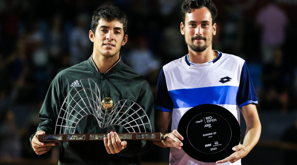 RIO DE JANEIRO, BRAZIL - FEBRUARY 23: Cristian Garin (L) of Chile and Gianluca Mager of Italy pose on the podium after the singles final of the ATP Rio Open the men's singles final match at Jockey Club Brasileiro on February 23, 2020 in Rio de Janeiro, Brazil. (Photo by Buda Mendes/Getty Images)