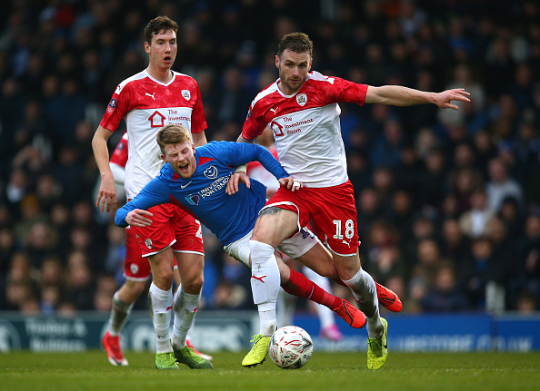PORTSMOUTH, ENGLAND - JANUARY 25: Andy Cannon of Portsmouth FC battles for possession with Michael Sollbauer of Barnsley during the FA Cup Fourth Round match between Portsmouth FC and Barnsley FC at Fratton Park on January 25, 2020 in Portsmouth, England. (Photo by Charlie Crowhurst/Getty Images)