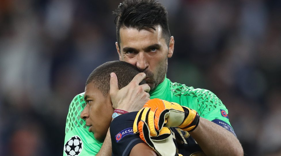 Juventus' goalkeeper from Italy Gianluigi Buffon (R) kisses Monaco's French forward Kylian Mbappe after Juventus won the UEFA Champions League semi final second leg football match Juventus vs Monaco, on May 9, 2017 at the Juventus stadium in Turin. / AFP PHOTO / Valery HACHE        (Photo credit should read VALERY HACHE/AFP via Getty Images)