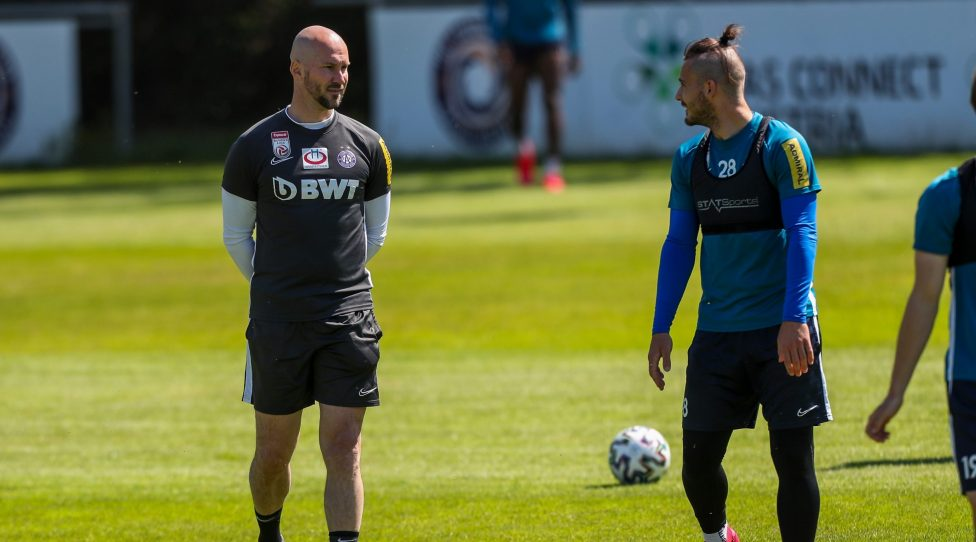 VIENNA,AUSTRIA,18.MAY.20 - SOCCER - tipico Bundesliga, FK Austria Wien, training after lightening the restrictions due to the SARS-CoV-2 crisis, corona crisis. Image shows head coach Christian Ilzer (A.Wien) and Christoph Martschinko (A.Wien). Photo: GEPA pictures/ Philipp Brem