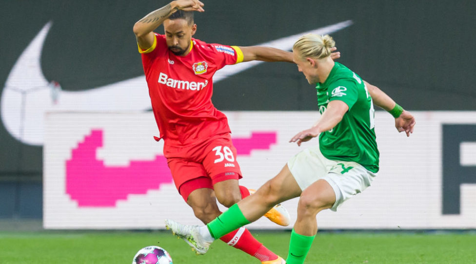 WOLFSBURG, GERMANY - SEPTEMBER 20: (BILD ZEITUNG OUT) Karim Bellarabi of Bayer 04 Leverkusen and Xaver Schlager of VfL Wolfsburg battle for the ball during the Bundesliga match between VfL Wolfsburg and Bayer 04 Leverkusen at Volkswagen Arena on September 20, 2020 in Wolfsburg, Germany. Fans are set to return to Bundesliga stadiums in Germany despite to the ongoing Coronavirus Pandemic. Up to 20% of stadium's capacity are allowed to be filled. Final decisions are left to local health authorities and are subject to club's hygiene concepts and the infection numbers in the corresponding region. (Photo by Mario Hommes/DeFodi Images via Getty Images)