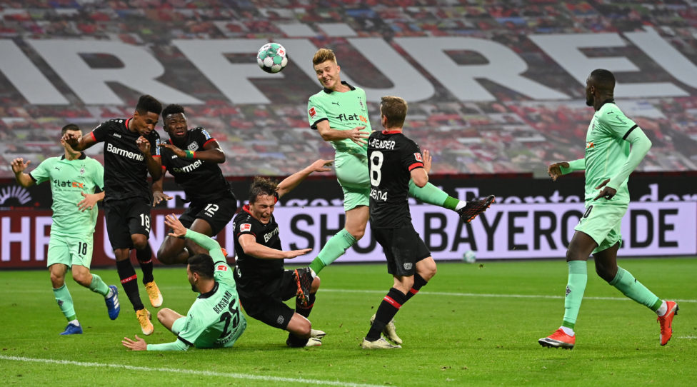 LEVERKUSEN, GERMANY - NOVEMBER 08:  Moenchengladbach's Nico Elvedi (C) heads the ball during the Bundesliga match between Bayer 04 Leverkusen and Borussia Moenchengladbach at BayArena on November 8, 2020 in Leverkusen, Germany. (Photo by Ina Fassbender - Pool/Getty Images)